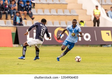 Ambato, Ecuador - March 30. 2019: Match by Liga Pro - Banco Pichincha in the city of Ambato between the Macará and U. Católica teams. Janner Corozo starts an attack behind the backs of his opponents.