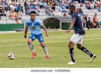 Ambato, Ecuador - March 30. 2019: Match by Liga Pro - Banco Pichincha in the city of Ambato between the Macará and U. Católica teams. Ronald Champang starts facing one of his opponents.