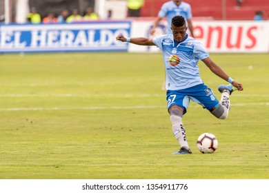 Ambato, Ecuador - March 30. 2019: Match by Liga Pro - Banco Pichincha in the city of Ambato between the Macará and U. Católica teams. Arboleda carries the ball and lifts a long pass.