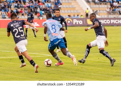 Ambato, Ecuador - March 30. 2019: Match by Liga Pro - Banco Pichincha in the city of Ambato between the Macará and U. Católica teams. Leonel Quiñónez successfully faces 3 opponents.