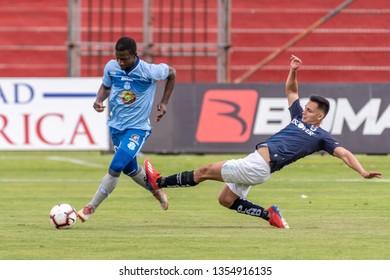 Ambato, Ecuador - March 30. 2019: Match by Liga Pro - Banco Pichincha in the city of Ambato between the Macará and U. Católica teams. Kéner Arce receives a very hard foul on his leg.