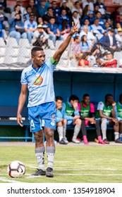 Ambato, Ecuador - March 30. 2019: Match by Liga Pro - Banco Pichincha in the city of Ambato between the Macará and U. Católica teams. Armando Gómez shoots a corner in the first half of the game.