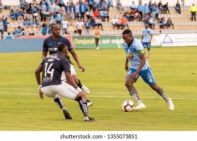 Ambato, Ecuador - March 30. 2019: Match by Liga Pro - Banco Pichincha between the Macará and U. Católica teams. Armando Gómez captain of Macará takes the ball.