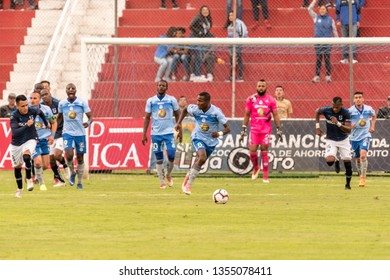 Ambato, Ecuador - March 30. 2019: Match by Liga Pro - Banco Pichincha between the Macará and U. Católica teams. Leonel Quiñonez supports the defenders and the attack begins.