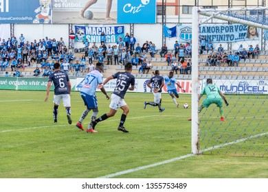 Ambato, Ecuador - March 30. 2019: Match by Liga Pro - Banco Pichincha between the Macará and U. Católica teams. Attack play by the left wing of Macará.