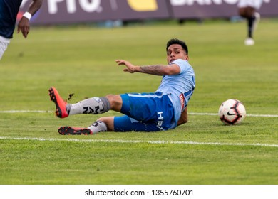 Ambato, Ecuador - March 30. 2019: Match by Liga Pro - Banco Pichincha between the Macará and U. Católica teams. Roland Champang falls to the floor due to the brusque play of his opponents.