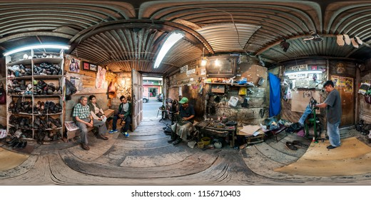 Ambato, Ecuador. October 3, 2015: neighborhood cobbler working in his small workshop. Full spherical 360 degrees seamless panorama in equirectangular equidistant projection, photo for VR AR content