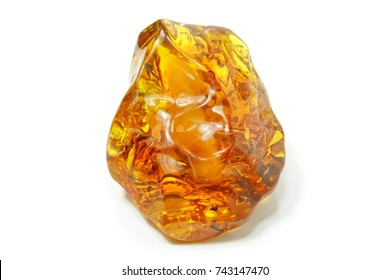 Amber. Beautiful polished red yellow piece of amber on a white background. Natural resin. Natural mineral amber is a frozen ancient resin. Jewelry stone. Color mineral. Insects in amber.