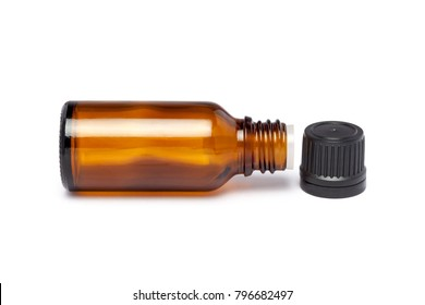 Amber color small pharma grade empty glass bottle with black cap and dropper.