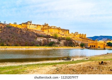 Amber Fort nearby Maota lake in Jaipur, Rajasthan, India,  Fort is an extensive palace complex, built from pale yellow and pink sandstone.