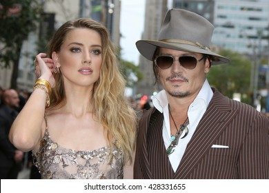 amber heard and johnny depp attending the danish girl film premiere during toronto international film festival on 12 september 2015, in toronto, canada