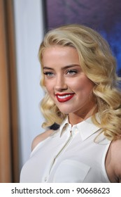 "Amber Heard at the Los Angeles premiere of ""Sherlock Holmes: A Game of Shadows"" at the Village Theatre, Westwood. December 6, 2011  Los Angeles, CA Picture: Paul Smith / Featureflash"
