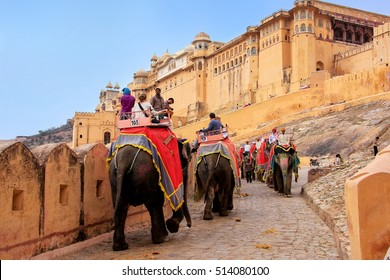 AMBER, INDIA - MARCH 1: Unidentified people ride decorated elephants to Amber Fort on March 1, 2011 in Amber, India. Elephant rides are popular tourist attraction in Amber Fort
