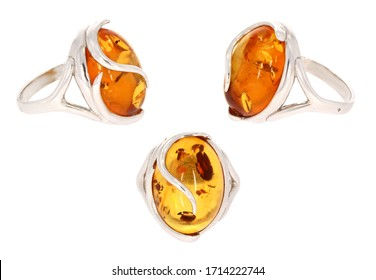 Amber jewelry ring. Natural Baltic amber. Isolated cut out image. Vintage and modern style fashion jewelry.