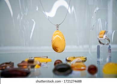 Amber necklace  on the glass shelf. Close up.