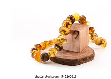 Amber necklace on olive wood cubes
