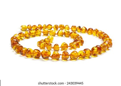 Amber necklace in spiral isolated on the white background