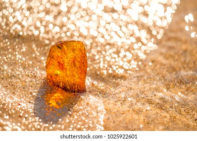 Amber on a beach of the Baltic Sea in the surf