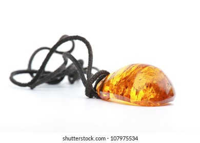 Amber pendant isolated on a white background
