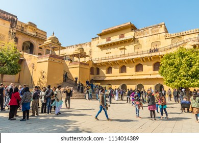 Amber, Rajasthan, India - 12th January 2017:  Tourists in the courtyard of Amber Fort  in Rajasthan, India.