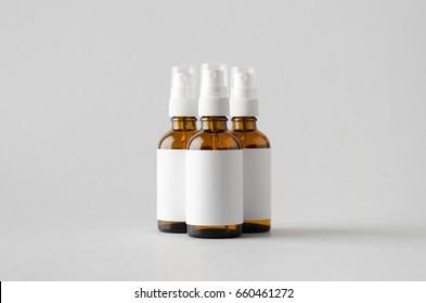 Amber Spray Bottle Mock-Up - Three Bottles. Blank Label