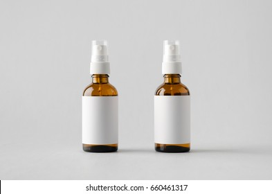 Amber Spray Bottle Mock-Up - Two Bottles. Blank Label