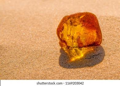 amber in sun on a beach