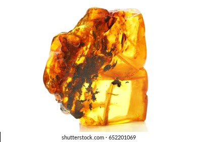 Amber with sunlight on a white background. A piece of vintage mineral with inclusions inside. A colorful sunstone is bright and yellow on white. Amber texture.