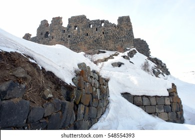 Amberd Fortress in Armenia country. Winter beautiful mountain landscape. Old christianity church and monastery