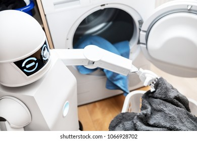 ambient assisted living robot or cyborg is working in the household. robot is putting some clothes in the dryer