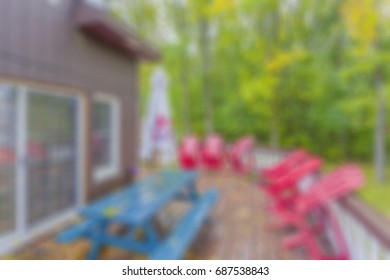 ambiguous, defocused view of an outdoor patio at a residential home