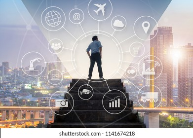 Ambitions businessman climbed on top of the stairs going to the city with Internet of things (IOT), Internet networking and global wireless devices concept.