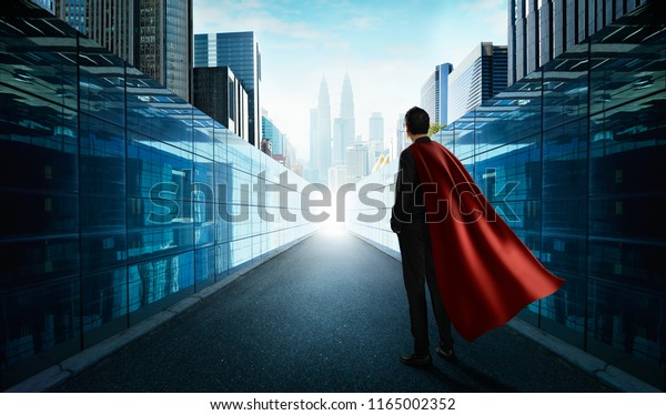 Ambitions concept with hero businessman standing and looking from alley to modern city .