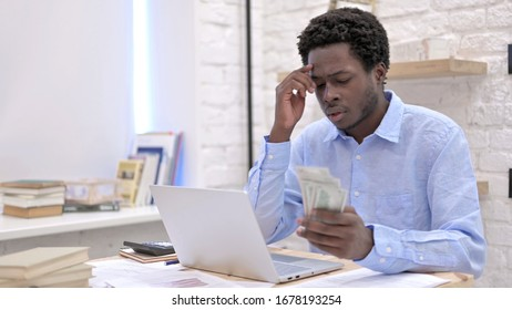 Ambitious African Man Counting Money And thinking