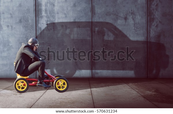 Ambitious Businessman on a pedal car