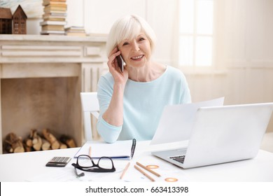 Ambitious elderly lady managing the project from home