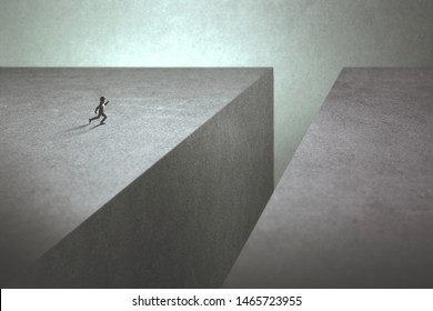 ambitious man taking run up to make a big jump to reach the other side of the precipice