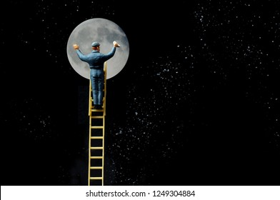Ambitious window cleaner climbs ladder to the moon conceptual metaphor