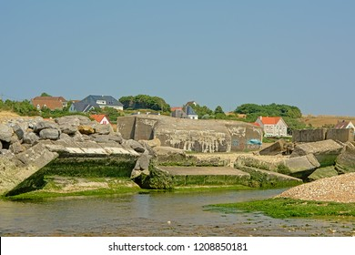 AMBLETEUSE, FRANCE, JULY 25, 2018, Ruins of of concrete world war two bunkers along river Slack mouth in the North sea in Ambleteuse , 25 July 2018