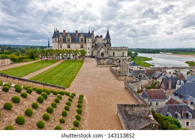 Amboise castle from the gardens under a cloudy sky