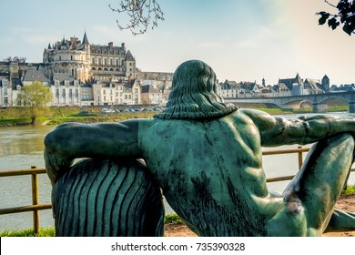 Amboise castle with Leonardo da Vinci statue near Loire river at sunset, France