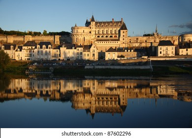 Amboise castle at sunset light and its reflection in Loire river (Loire Valley, France)