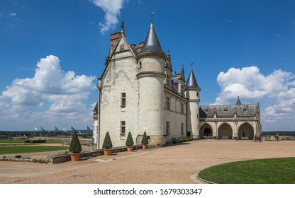 AMBOISE, FRANCE - AUGUST 01, 2014: Landscape with a medieval royal castle in the Chateau d'Amboise on a sunny summer day. This castle is a UNESCO world heritage site.