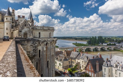 AMBOISE, FRANCE - AUGUST 01, 2014: View of the medieval royal castle in the Chateau d'Amboise and the Loire River on a sunny summer day. This castle is a UNESCO World Heritage Site.