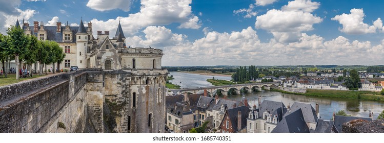 AMBOISE, FRANCE - AUGUST 01, 2014: Panoramic view of the medieval royal castle in the Chateau d'Amboise and the Loire River on a sunny summer day. This castle is a UNESCO World Heritage Site.