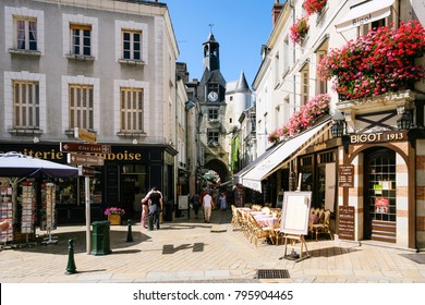 AMBOISE, FRANCE - JULY 8, 2010: people near clock tower (Tour De L'Horloge) on street Rue Nationale in Amboise town. Amboise is commune in the Indre-et-Loire department on the banks of the Loire River