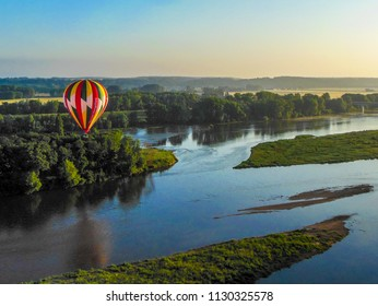 Amboise, Loire Valley / France - June 12 2012: View of a hot air balloon over the Loire River in the early morning