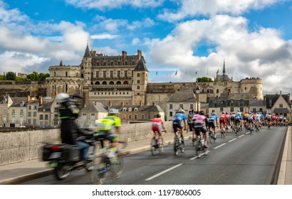 Amboise,France - October 8,2017: Blurred image of the peloton passing on the bridge in front of Amboise Castle during the Paris-Tours road cycling race.