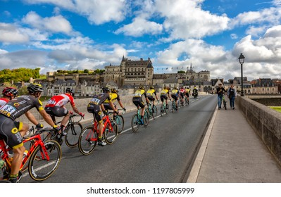 Amboise,France - October 8,2017: The peloton passing on the bridge in front of Amboise Castle during the Paris-Tours road cycling race.