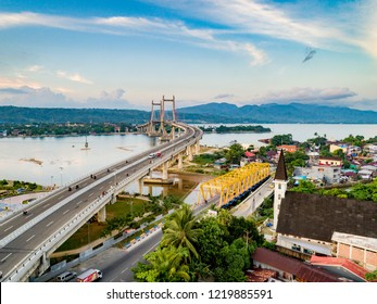 Ambon, Indonesia - October 25, 2018: Scenic Aerial View of Iconic Merah Putih Cable Stayed Bridge accross Ambon Bay and Wai Ruhu Galala Yellow Truss Bridge, Maluku